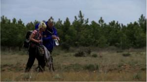 Sam walks along the Camino with a fellow pilgrim.